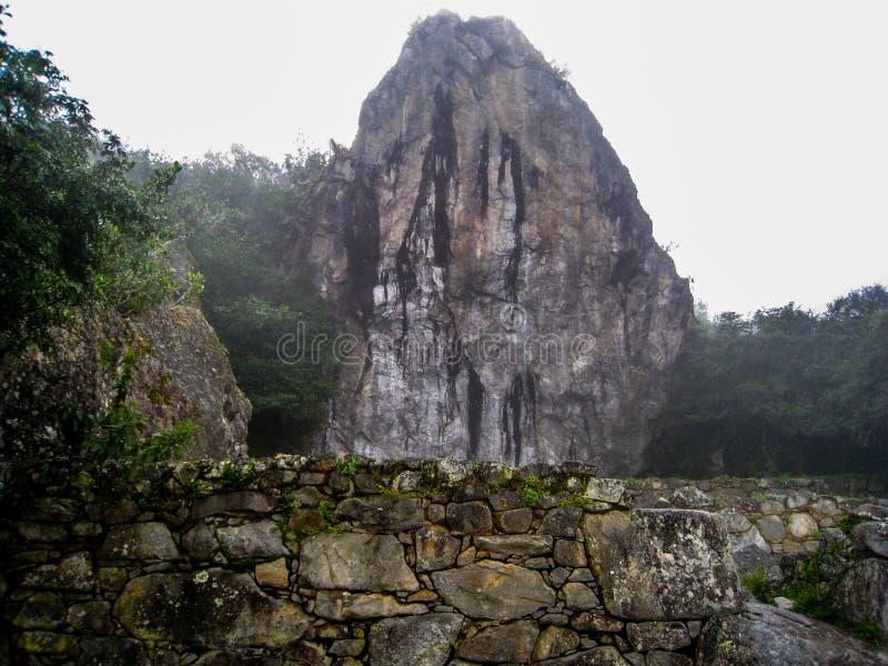 Stone ancient ruins along the Inca Trail to Machu Picchu in Peru. Stone magical ancient ruins along the paved path Inca Trail to Machu Picchu in Peru stock image