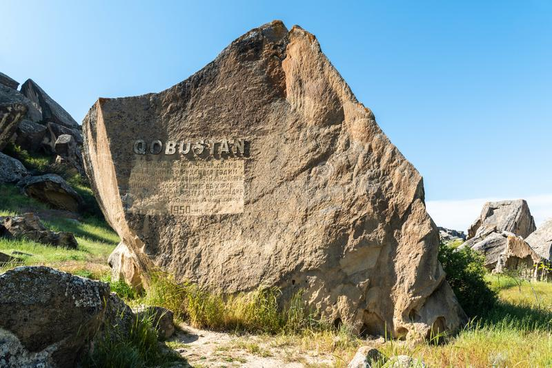 Stone marking entrance to Gobustan national park in Azerbaijan stock photo