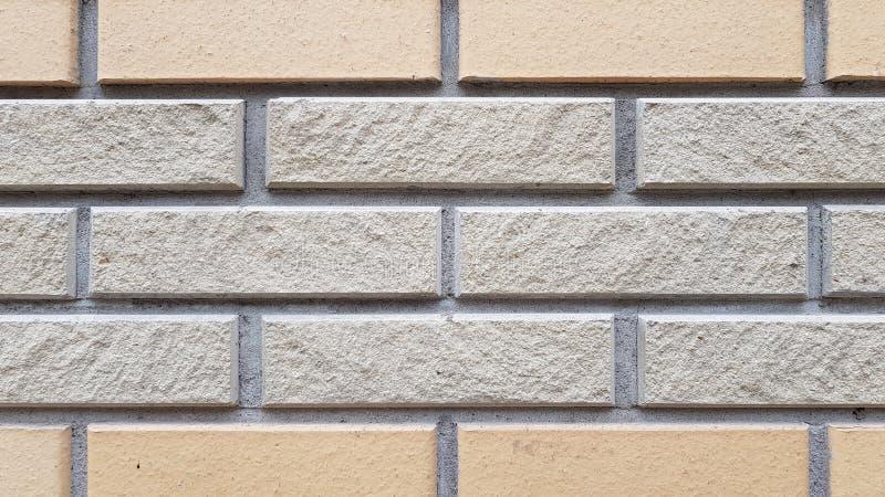 Two types of rectangular brick tiled wall. Brick pattern textured background. Brickwork backdrop. Stone masonry wall surface. stock image