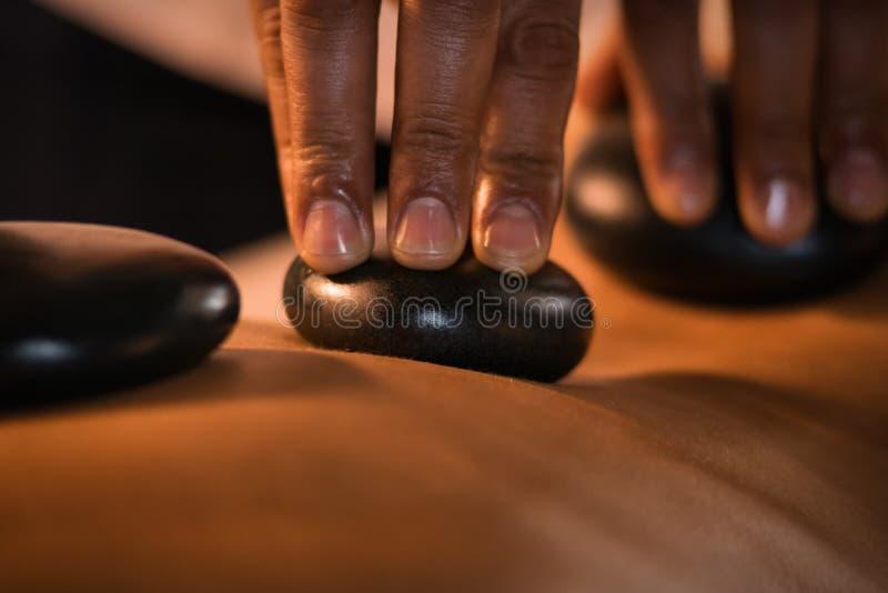 Stone massage closeup royalty free stock image
