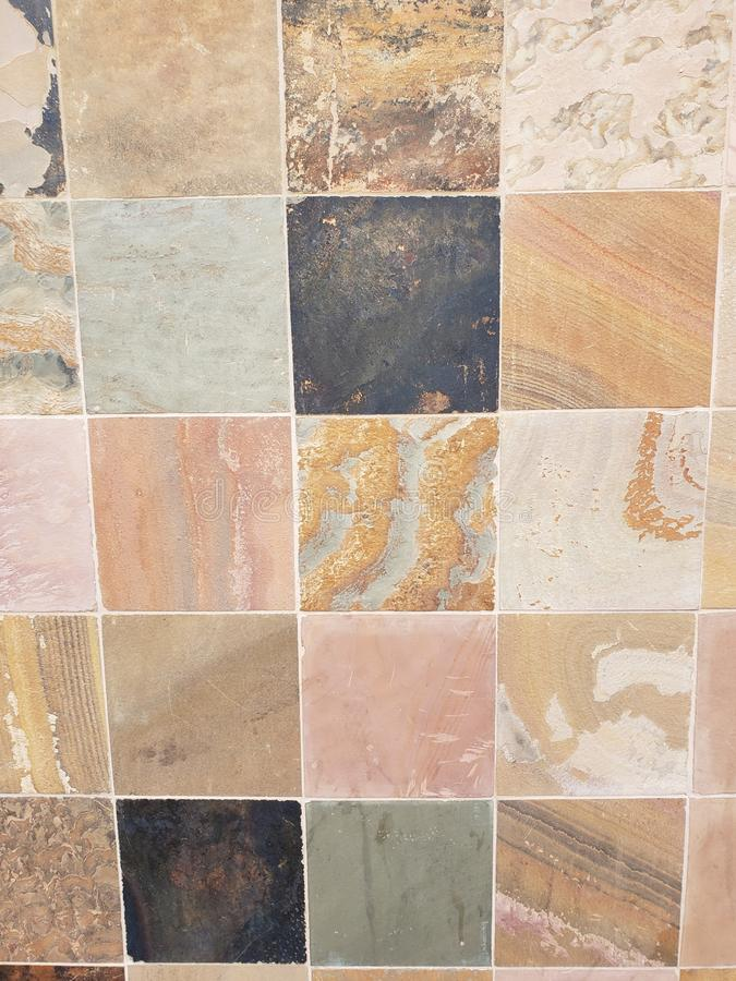 surface with stone blocks in brown colours for walls and floors, background and texture royalty free stock image