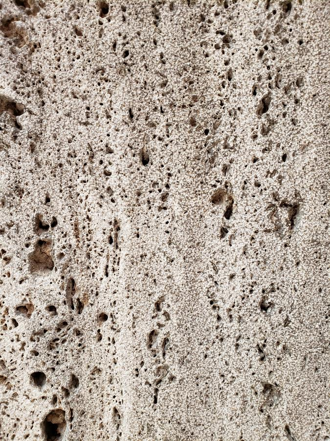 Approaching a porous stone surface in grey, background and texture. Stone material with luxurious appearance and elegance for floor and wall decor, used by royalty free stock images