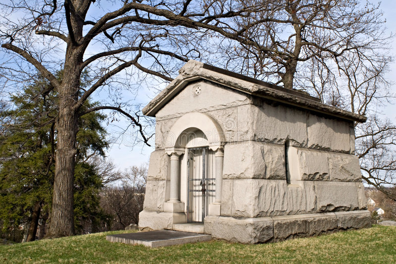 Stone Mausoleum. Private mausoleum, c. 1892, stands by itself on the hilltop of a cemetery stock photography