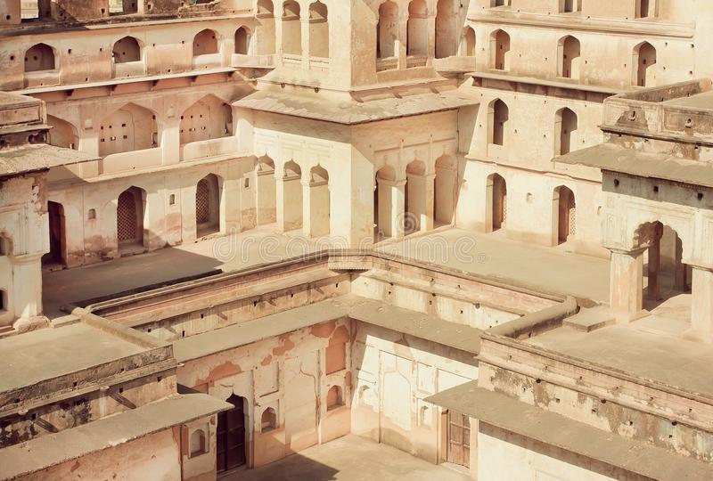 Stone maze of arches and columns inside the indian palace. Example of classical architecture of India. Historical structure, walls built in old times royalty free stock photo