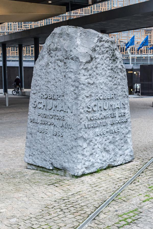 Stone memorial to Robert Schuman next to Berlaymont buildings stock image