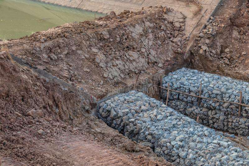 Stone in the mesh prevents erosion royalty free stock image