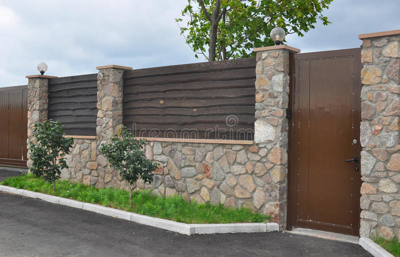 Download Stone And Metal Fence With Door Of Modern Style Design Decorative Cracked Real Stone Wall Stock Photo - Image: 62733254