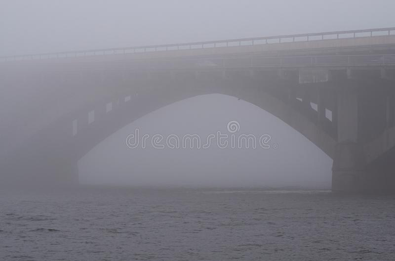 Stone Metro subway bridge in rich fog, mist background. Winter morning view. Kyiv, Ukraine stock photo