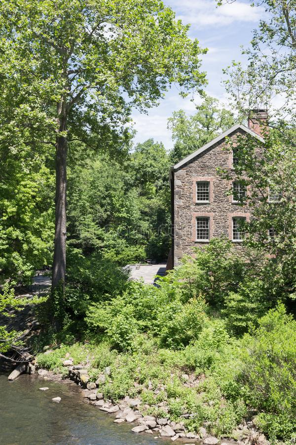 Stone Mill Building. BRONX, NY, USA - JUNE 9, 2017: NY BOTANICAL GARDEN. The Goldman Stone Mill building on the grounds of NYBG. The Stone Mill is a National stock photography