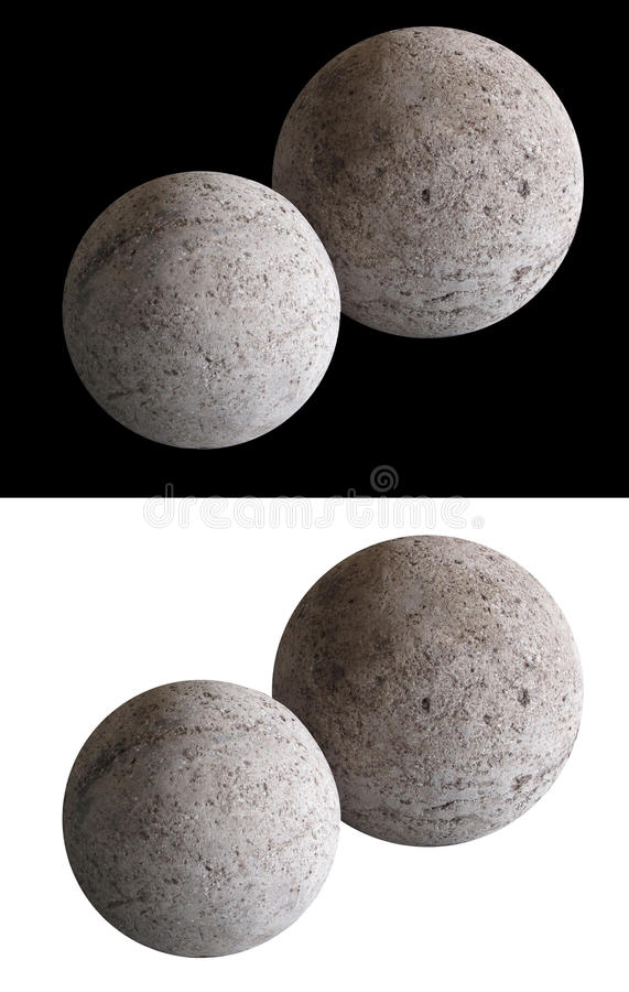 Stone Moon Spheres. A pair of decorative soft lit man made concrete moon shaped spheres shown isolated on both black and white backgrounds stock photography