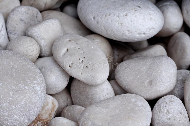 Stone more close up. Beautiful round stone at a beach in Italy the love beach royalty free stock photos