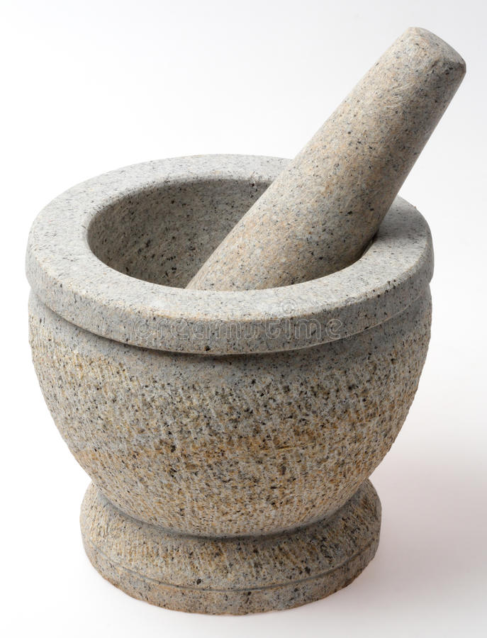 Stone mortar and pestle. Isolated on white royalty free stock images
