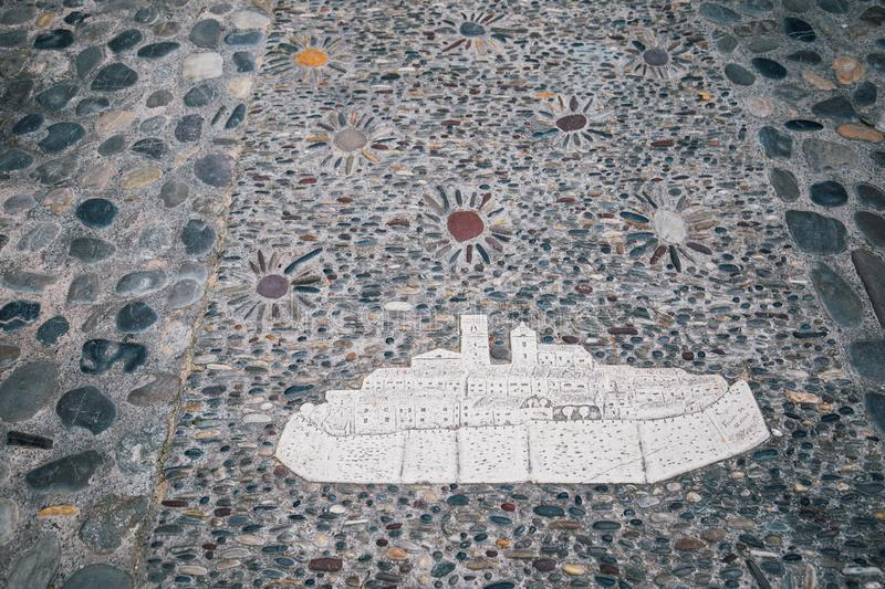 Stone mosaic on floor illustrating old city St. Paul de Vence, France, Cote d`Azur royalty free stock image