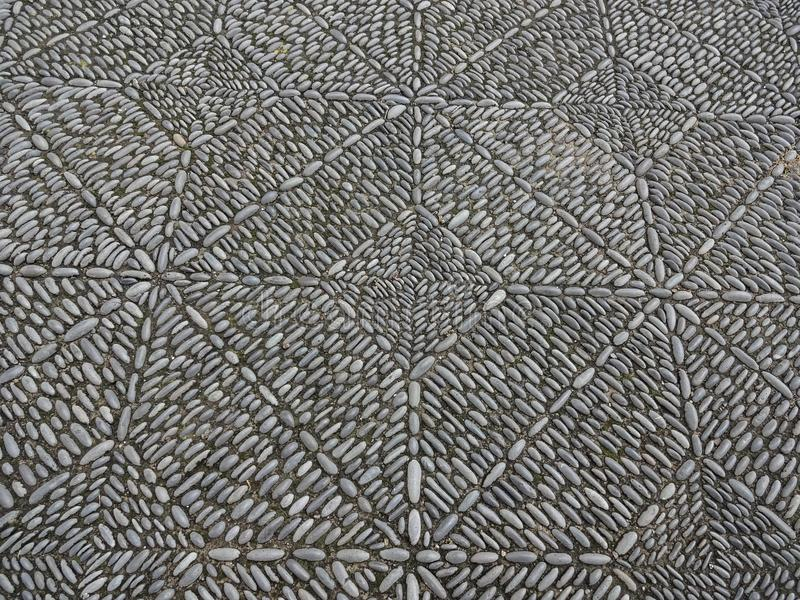 Stone mosaic pavement, beautiful cobble stone sidewalk stock image