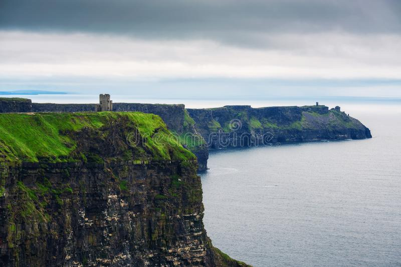 Stone observation tower at Cliffs of Moher in Ireland royalty free stock image
