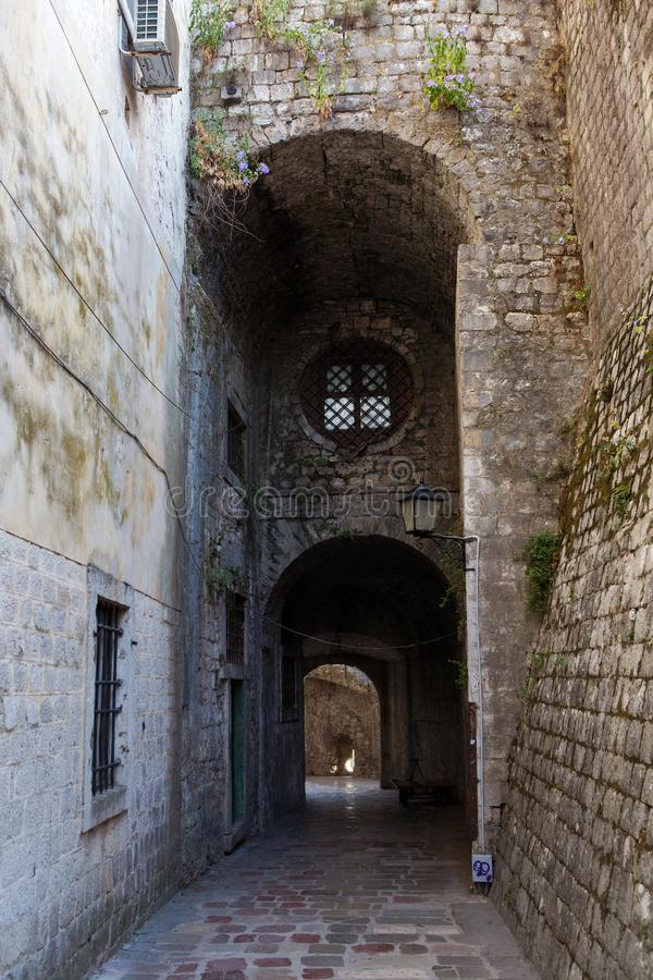 Stone old corridor with round window royalty free stock photography