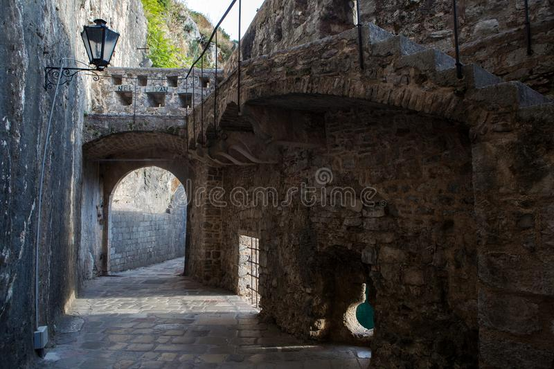 Stone old corridor with round window royalty free stock images