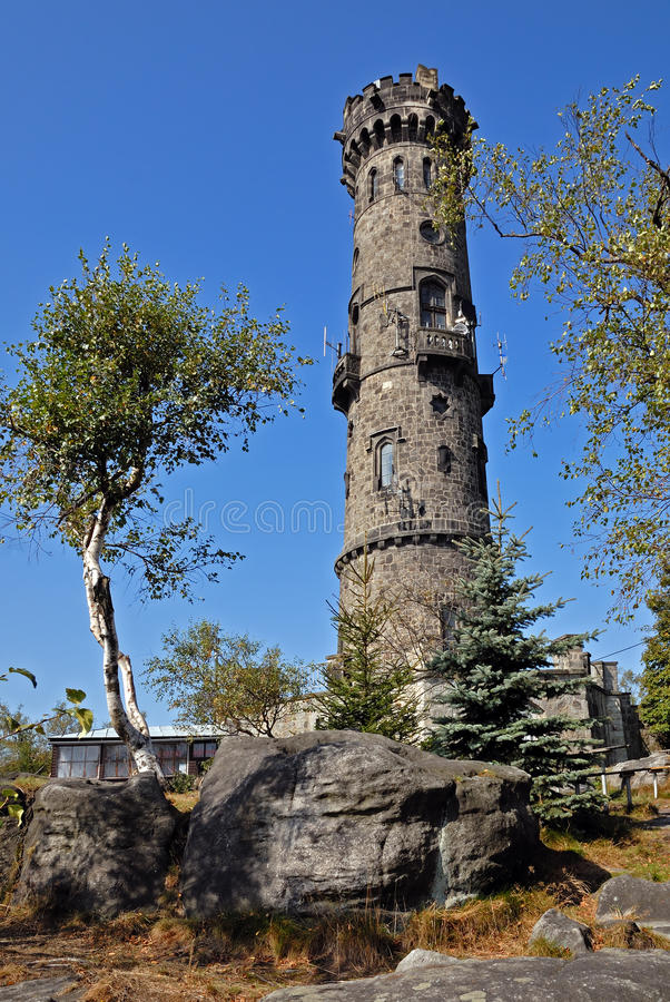Stone outlook tower, Decinsky Sneznik. Historical outlook tower is be located in North of Czech Republic stock images