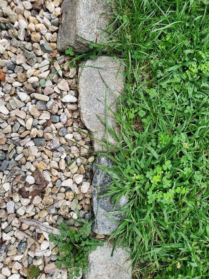 Stone path through Green Meadow overhead shot close up texture. Rocks on one side build stones in center grass on the other stock images