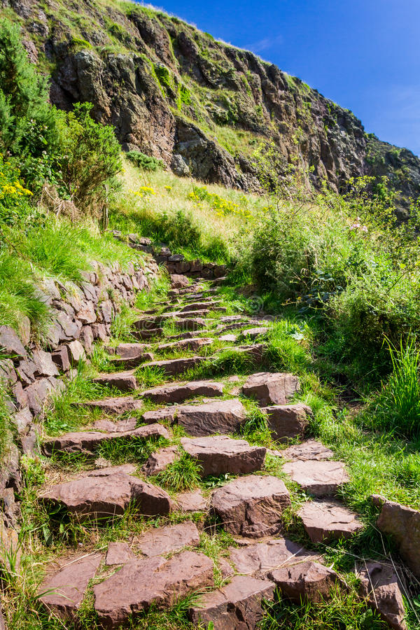 Stone path in the mountains leading to the peak royalty free stock photo