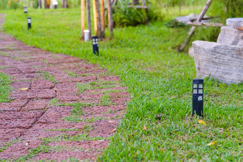 Stone pathway with outdoor lights in Garden - Walkway s curve.  royalty free stock images
