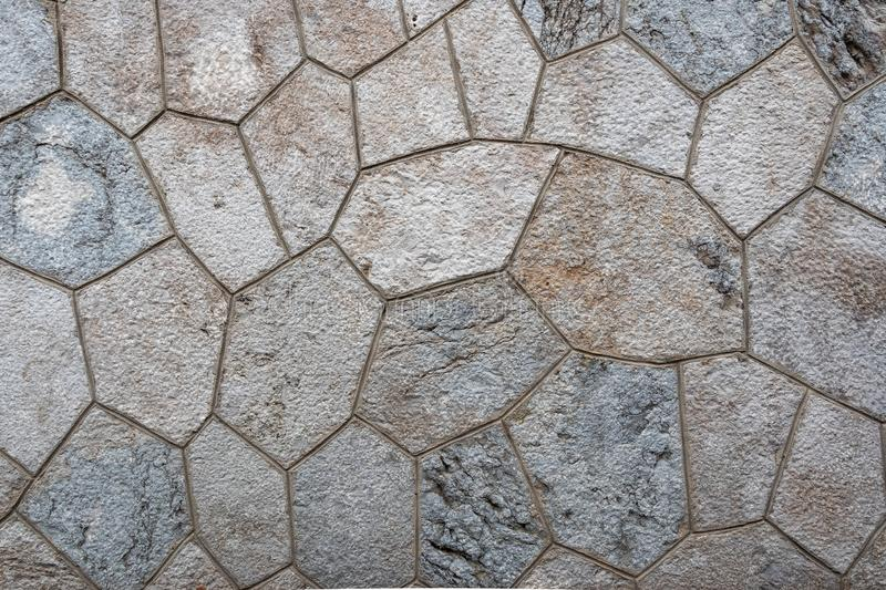 Fragment of a mosaic of stones. Floor covering. royalty free stock images