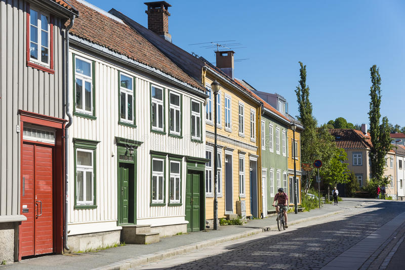 Stone paved street Bakklandet Trondheim. Stone paved street with colourful old wooden residential town houses at Bakklandet in Trondheim, Norway stock image