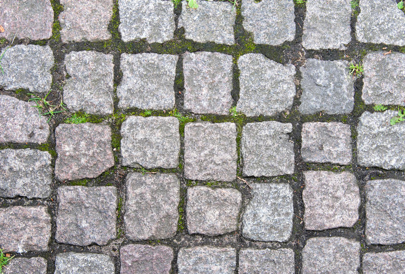 Stone pavement in Europe. Texture and background stock photography