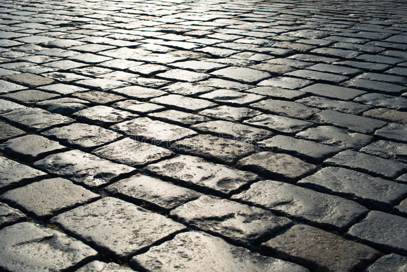 Stone pavement in perspective. grey block texture. And pattern royalty free stock photos