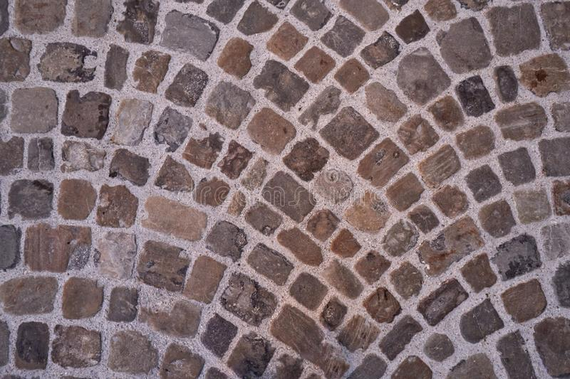 Stone pavement texture. Abstract background of old cobblestone pavement close-up stock photos