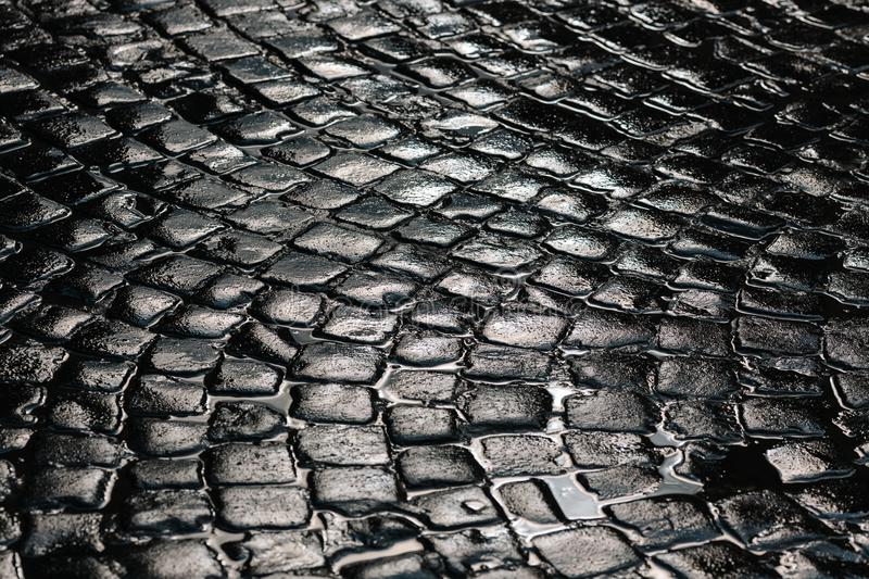 Stone pavement texture. Granite cobble stoned pavement background. Abstract background of old cobblestone pavement close royalty free stock image