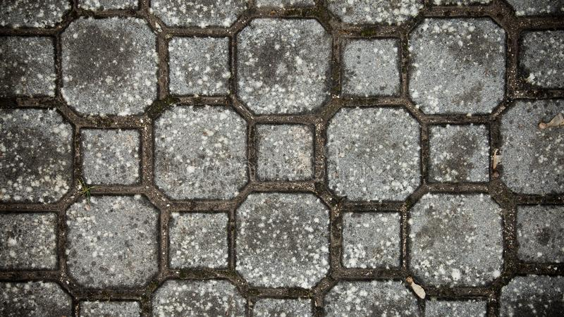Stone pavement texture. Granite cobble stoned pavement background. Abstract background of old cobblestone pavement close-up. Seaml stock photos