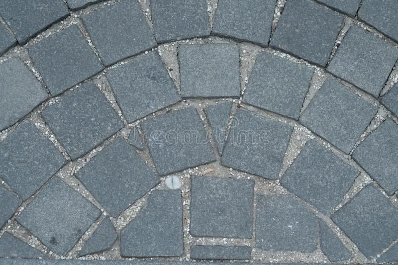 Stone pavement texture, granite cobblestoned pavement background, cobbled stone road regular shapes, abstract background of old stock image