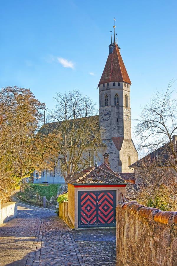Stone paving road to Thun City Church in Switzerland stock photography