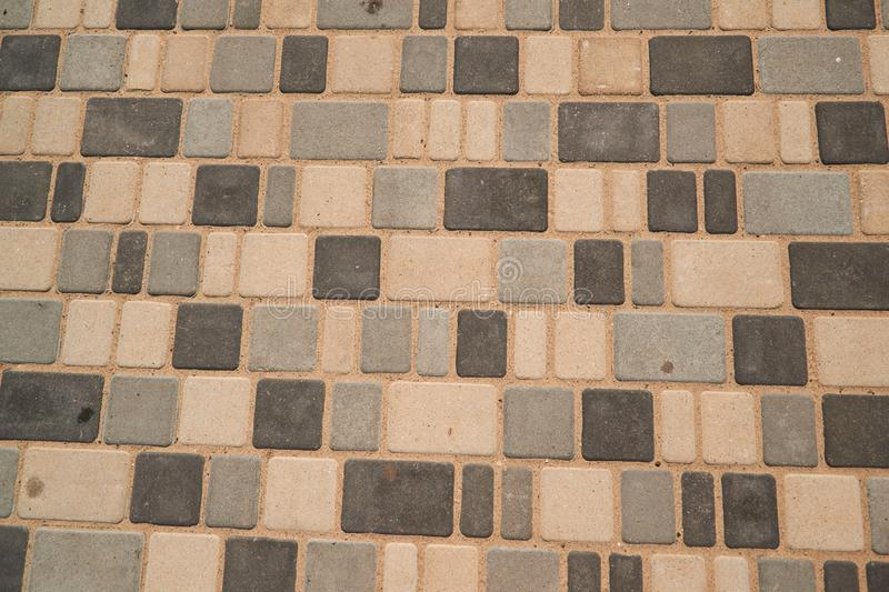 Stone paving texture. Abstract pavement background. Selective focus stock images
