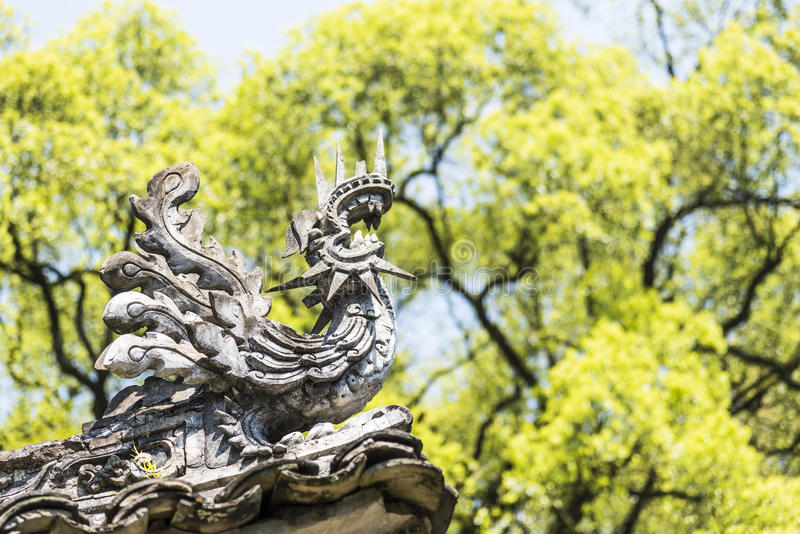 The stone Phoenix at the top of door royalty free stock photo