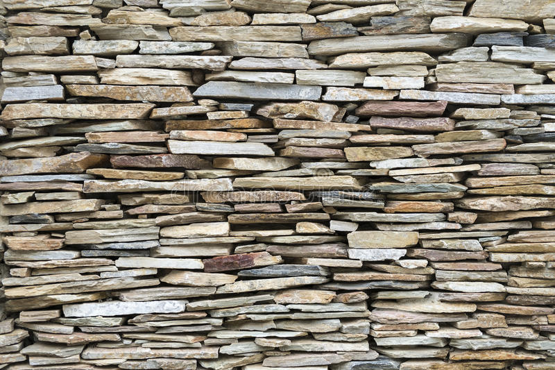Stone in pieces cladding on wall. Piece of stone in various size cladding on wall royalty free stock image