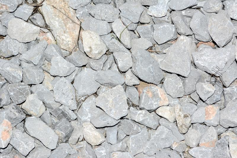 Stone pieces. Small stones broken through big rocks. pebbles on the ground royalty free stock photo