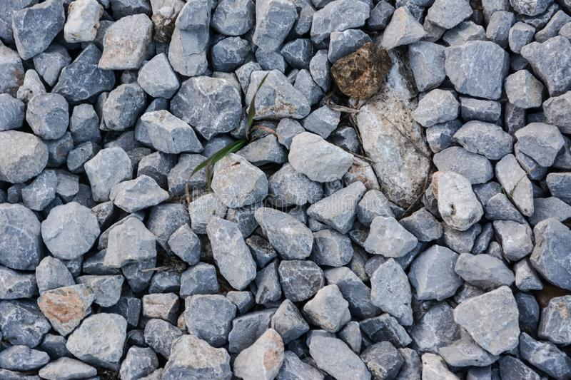 Stone pieces. Small stones broken through big rocks. pebbles on the ground royalty free stock photography