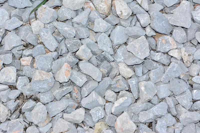 Stone pieces. Small stones broken through big rocks. pebbles on the ground royalty free stock image