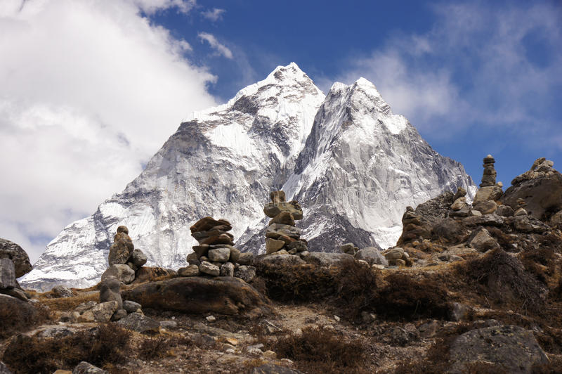 Stone piles and great mountains stock photography