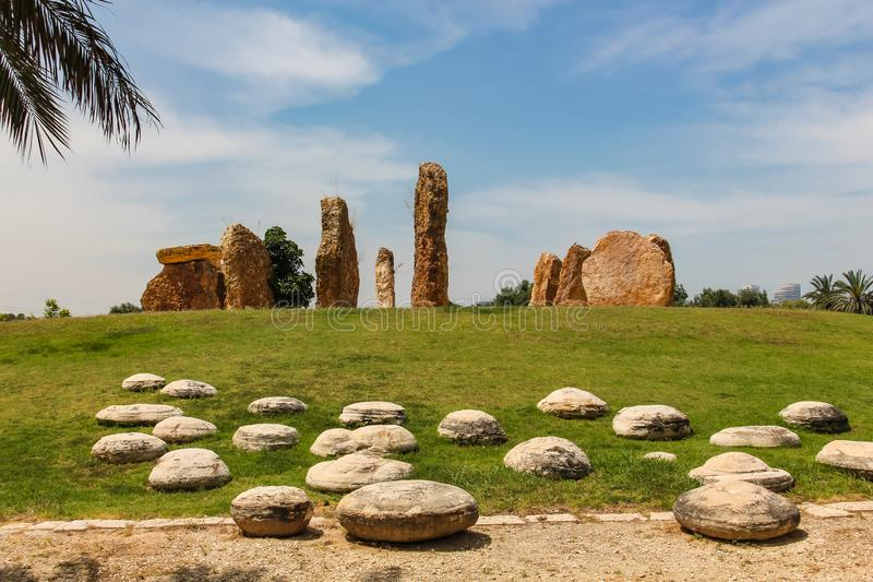 Stone pillars stand in a circle in a park in Israel.  stock image