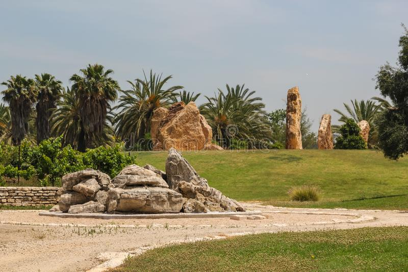Stone pillars stand in a circle in a park in Israel.  royalty free stock photo