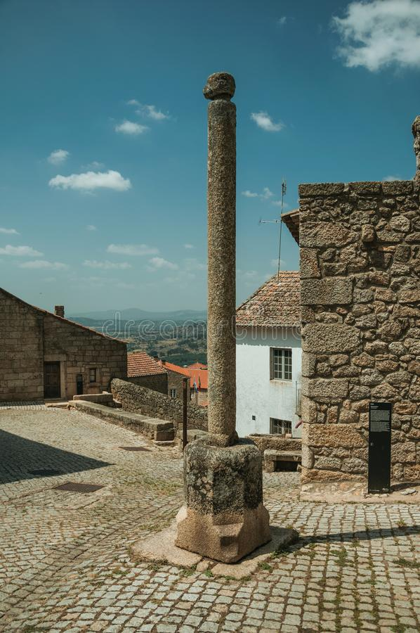 Stone pillory in front of old stone houses at Monsanto royalty free stock image
