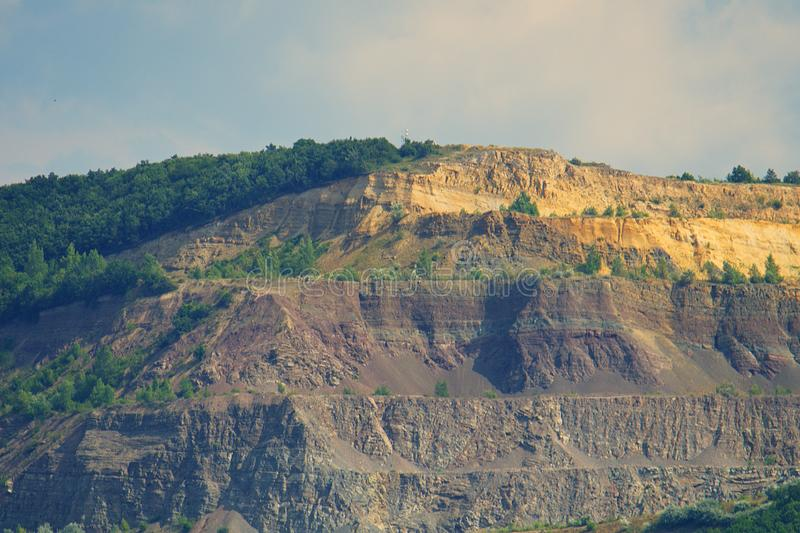 Stone-pit in Hungary. Photographed from Slovakia by the Danube stock photos