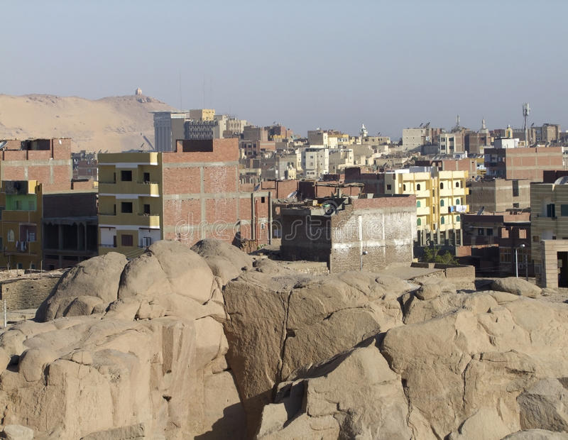 Stone pit near Aswan. Stone pit in front of a city named Aswan (Egypt) in sunny ambiance stock photo