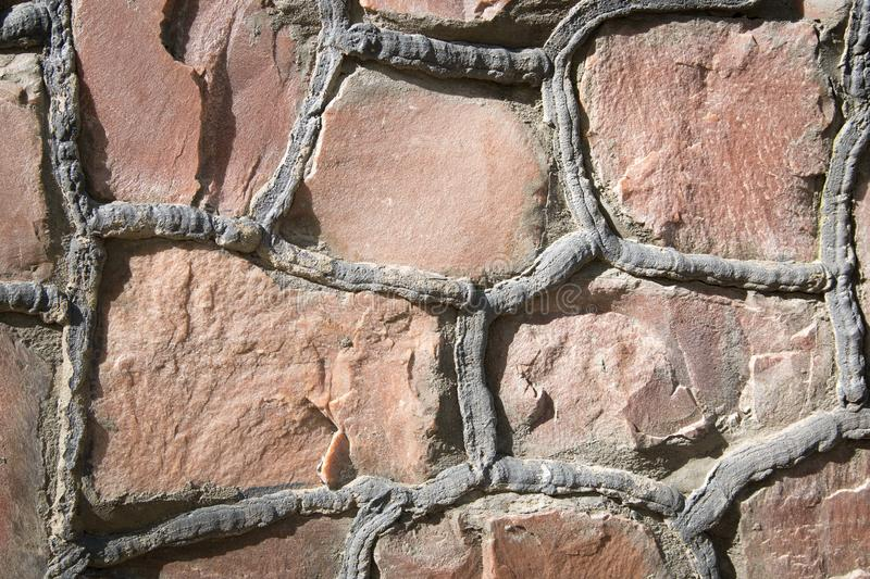 Stone placed in the wall, interesting and original background, solid wall. Stone placed in the wall, interesting and original background, solid masonry wall royalty free stock images