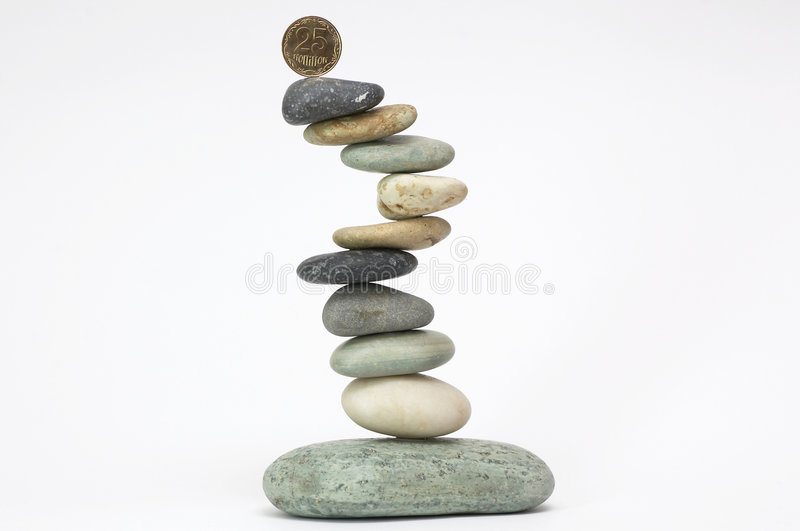 Stone pyramid with coin on top royalty free stock images