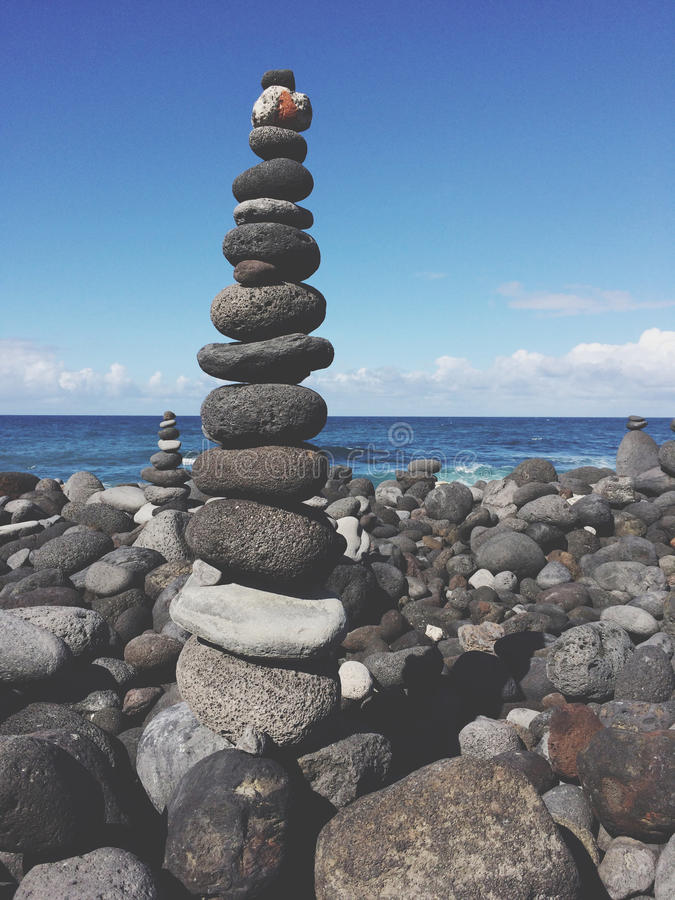 Stone pyramid, stacked pebble stones at beach. Stone pyramid, stacked pebble stone tower at beach stock images