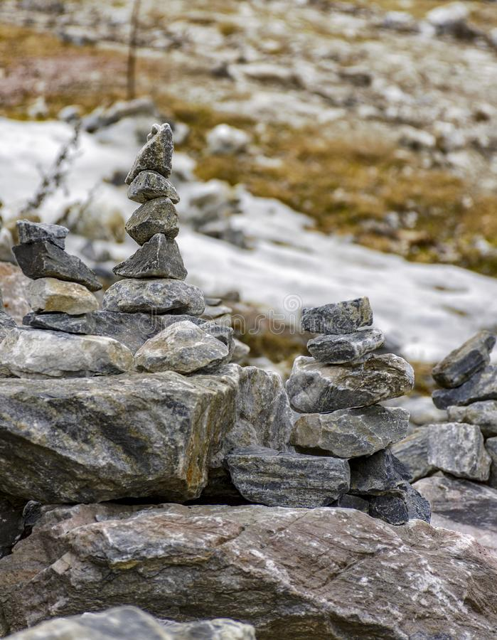 Stone pyramids built by tourists from pieces of marble in the mountain Park royalty free stock image